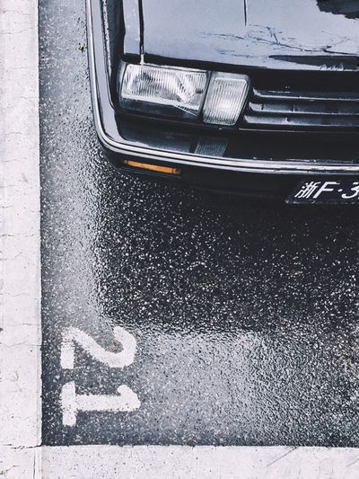 Transportation Mode Of Transportation Land Vehicle Car Motor Vehicle High Angle View No People Day Road City Street Outdoors Metal Asphalt Close-up Road Marking Marking Text Full Frame Vehicle Hood