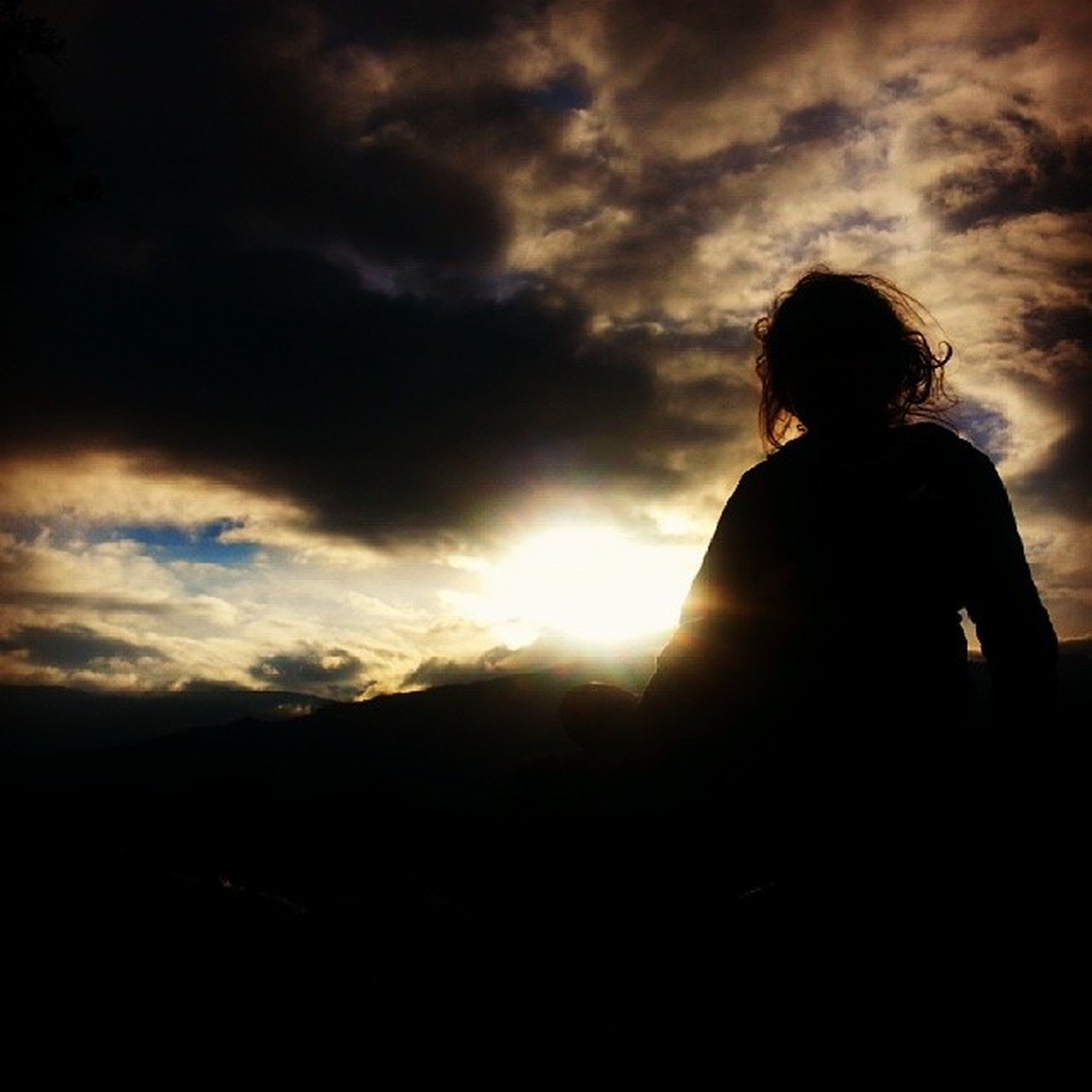 sky, silhouette, cloud - sky, lifestyles, leisure activity, sunset, rear view, cloudy, standing, tranquil scene, tranquility, scenics, beauty in nature, nature, cloud, sun, person, men