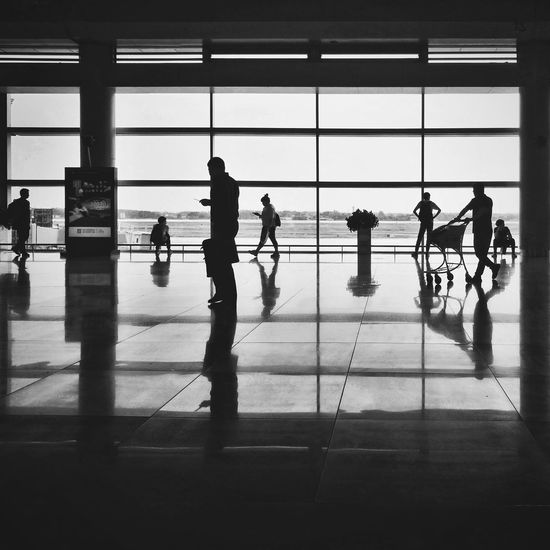 Silhouette Black And White Street Photography Light And Shadow Tranquility Full Length Men Silhouette Window Reflection Architecture Airport Departure Area Public Transportation Airport Terminal Transportation Building - Type Of Building Arrival Departure Board Moving Walkway  Airport
