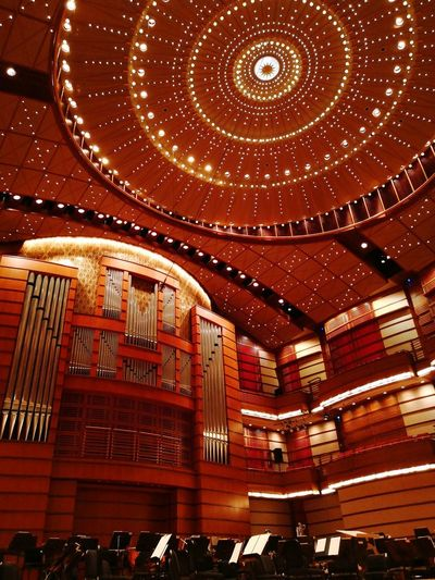 """Inside the Dewan Filharmonik Petronas for the """"Music from Anime"""" orchestra conducted by Naohisa Furusawa Orchestra Naohisa Furusawa Dewanfilharmonikpetronas Malaysianphilharmonicorchestra Illuminated Ceiling Lighting Equipment Architecture"""