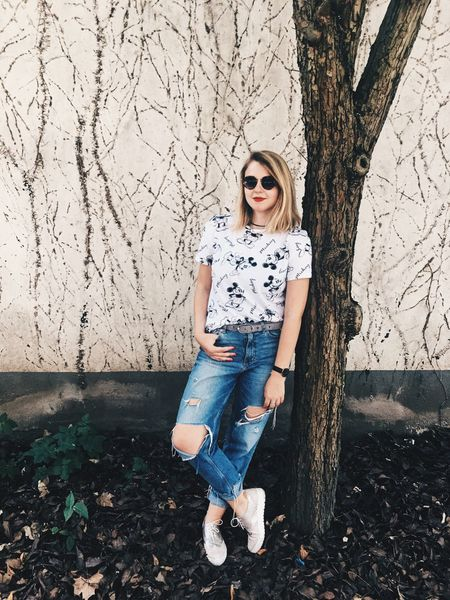 Streetphotography One Person Casual Clothing Only Women Tree Looking At Camera Fashion Streetstyle Mickey Mouse Sunglasses Ripped Jeans