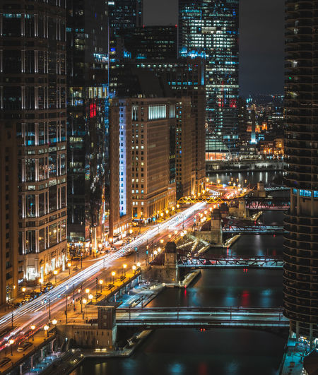 Rooftop view of Chicago city Chicago Architecture Chicago USA Illuminated Architecture Built Structure City Building Exterior Night Transportation Cityscape Building City Life No People Street Office Building Exterior Modern Bridge Road Motion Water Long Exposure Skyscraper Bridge - Man Made Structure Outdoors Financial District