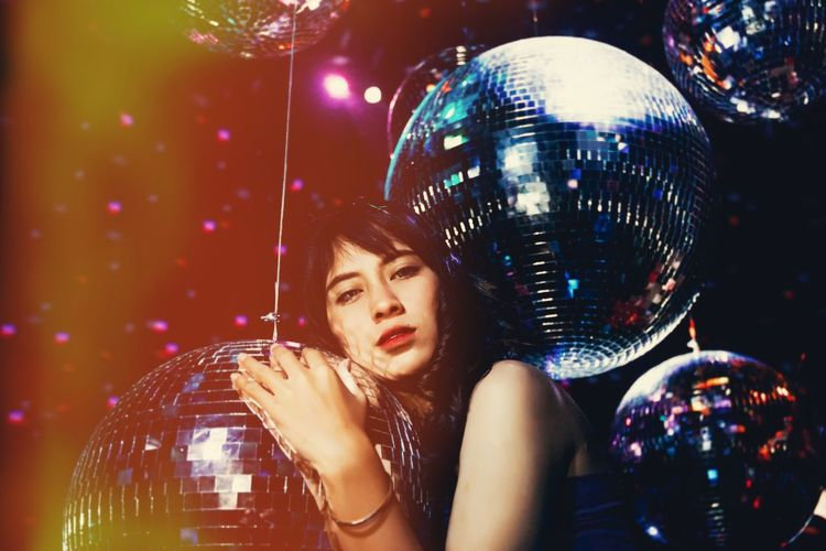 Beautiful Woman Disco Ball Disco Dancing Hairstyle Headshot Holding Illuminated Indoors  Night Nightclub Nightlife One Person Portrait Real People Reflection Shiny Silver Colored Sphere Women Young Adult Young Women Capture Tomorrow