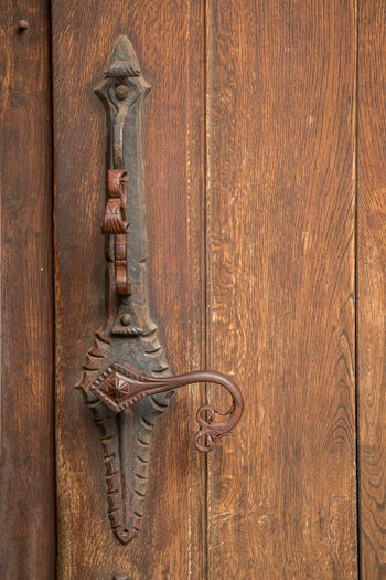 Door handle of an old historical building made of iron Wood - Material Entrance Door Metal Close-up Door Knocker Protection No People Old Brown Security Textured  Handle Backgrounds Ornate Closed Safety Doorknob Wood Antique Wood Grain Latch
