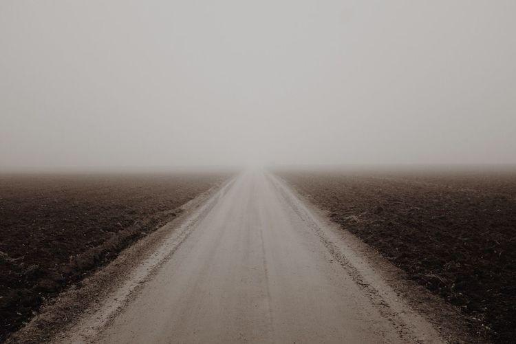 Road In Desert Against Clear Sky