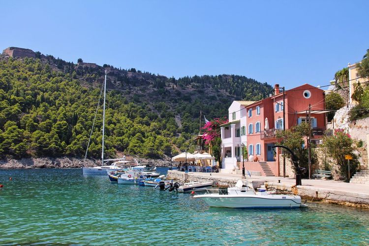 NewToEyeEm Colorful Houses Colorful Boats Boat Mountain Island Kefalonia, Greece Kefalonia Greece Traveling Travel Architecture Building Exterior Tree Clear Sky Nautical Vessel House Water Blue Travel Destinations Vacations Tranquility Outdoors Sea Nature No People