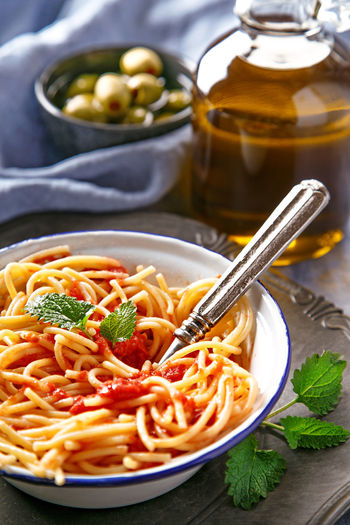 Italian pasta dish. Vegetarian spaghetti pasta with tomato sauce and olives Dinner Dish Food Food And Drink Freshness Italian Food Lunch Mediterranean Food Pasta Pasta Time Plate Tomato Vegetarian Food