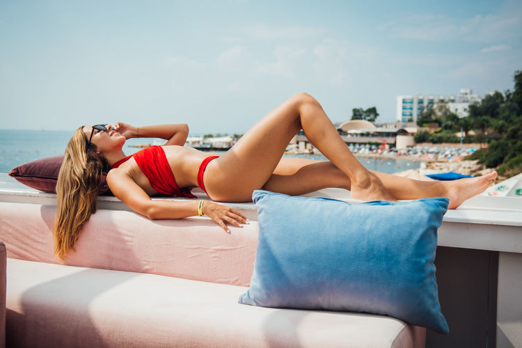 One Person Lying Down Relaxation Water Young Adult Real People Lifestyles Full Length Clothing Nature Sea Young Women Leisure Activity Women Day Sky Adult Beautiful Woman Outdoors
