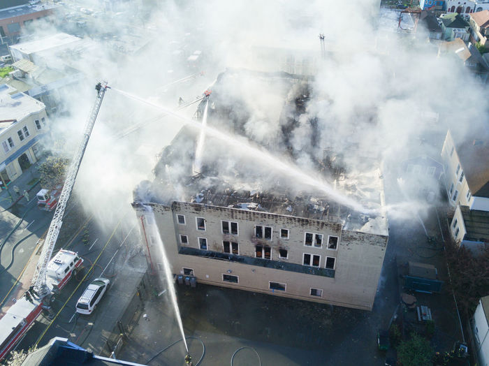 Aerial view of building being extinguished