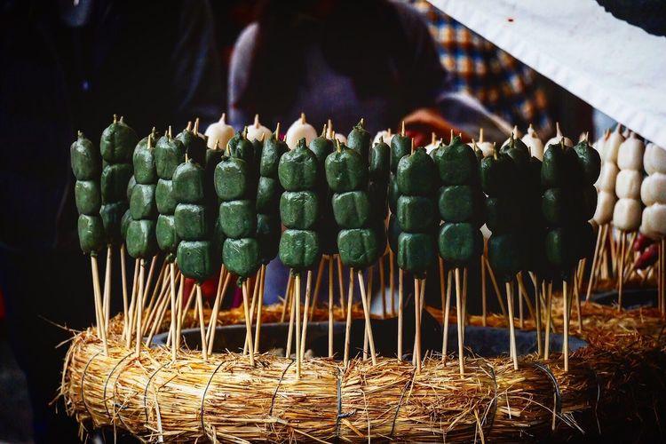 Close-up of vegetables on stick for sale at market