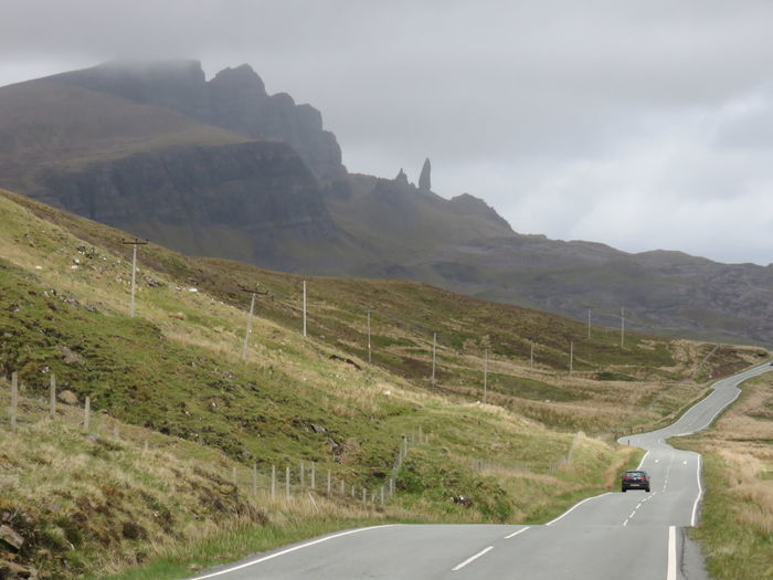 Beauty In Nature Country Road Diminishing Perspective Empty Road Isle Of Skye Landscape Mountain Mountain Range Mountains Nature Non-urban Scene Old Man Of Storr Road Road Road Marking Scenics Scotland Sky The Way Forward Tranquil Scene Tranquility Transportation Uk United Kingdom Vanishing Point