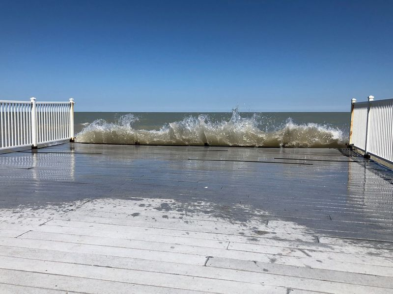 Waves crashing on the Pier Blue Sky Waves Crashing Waves Water Sky Sea Clear Sky Nature Beach Land No People Day Motion Architecture Built Structure Sunlight Scenics - Nature Horizon Over Water Blue Outdoors Tranquil Scene