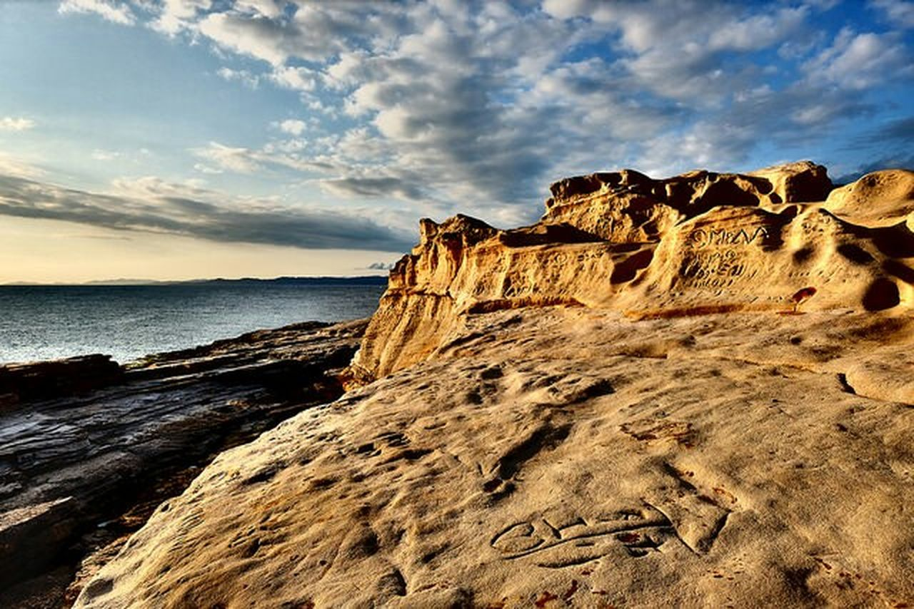 rock - object, nature, rock formation, sea, cloud - sky, scenics, beauty in nature, no people, sky, outdoors, horizon over water, beach, day, water