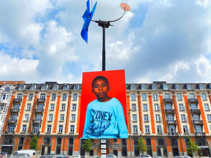 Downtown Street(art) Kid. Streetphotography Street Low Angle View Windmill Art ArtWork Architecture Outdoors Sky Day Walkway Blue Lifestyles Built Structure Facades Walking Around Molenbeek-saint-jean Brussel / Bruxelles / Brussels