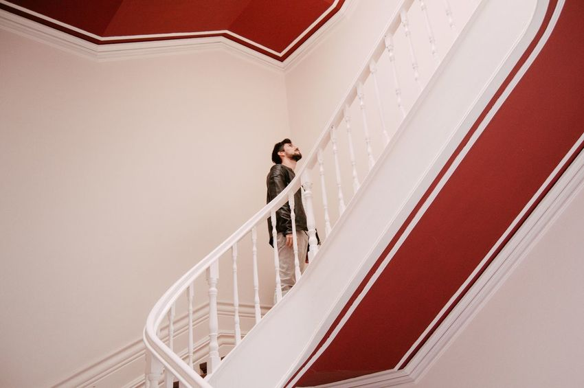 Up we go The Week On EyeEm Adult Adults Only Architecture Day Indoors  Low Angle View Men One Man Only One Person Only Men People Railing Staircase Standing Steps Steps And Staircases Young Adult