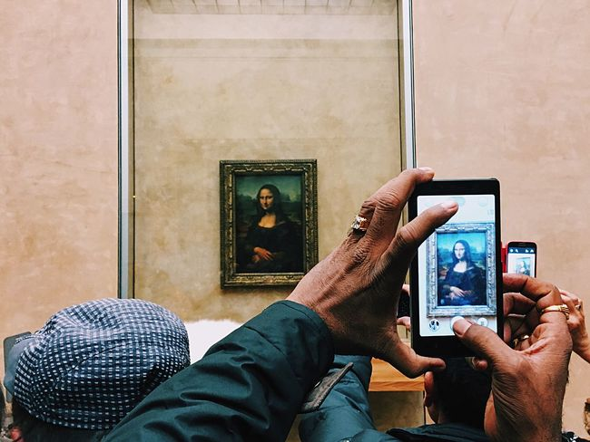 Two Is Better Than One Two Mona Lisas is better than one! Technology Hand Wrinkles Smartphone Monalisa Paris Louvre Museum Photographing Gioconda