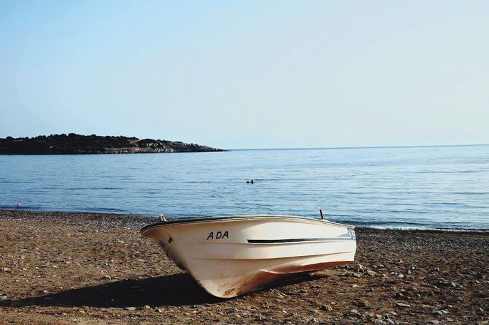 Boat Nautical Vessel Water Sea Transportation Beach Tranquil Scene Tranquility Moored Clear Sky Sand Copy Space Horizon Over Water Blue Shore Scenics Mode Of Transport Coastline Beauty In Nature Summer