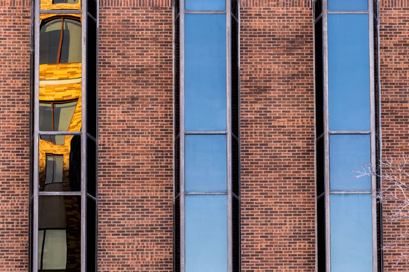 Reflection Architecture Backgrounds Blue Brick Wall Building Exterior Built Structure Day Full Frame Minimalism Multi Colored No People Outdoors Red Window Yellow The Graphic City