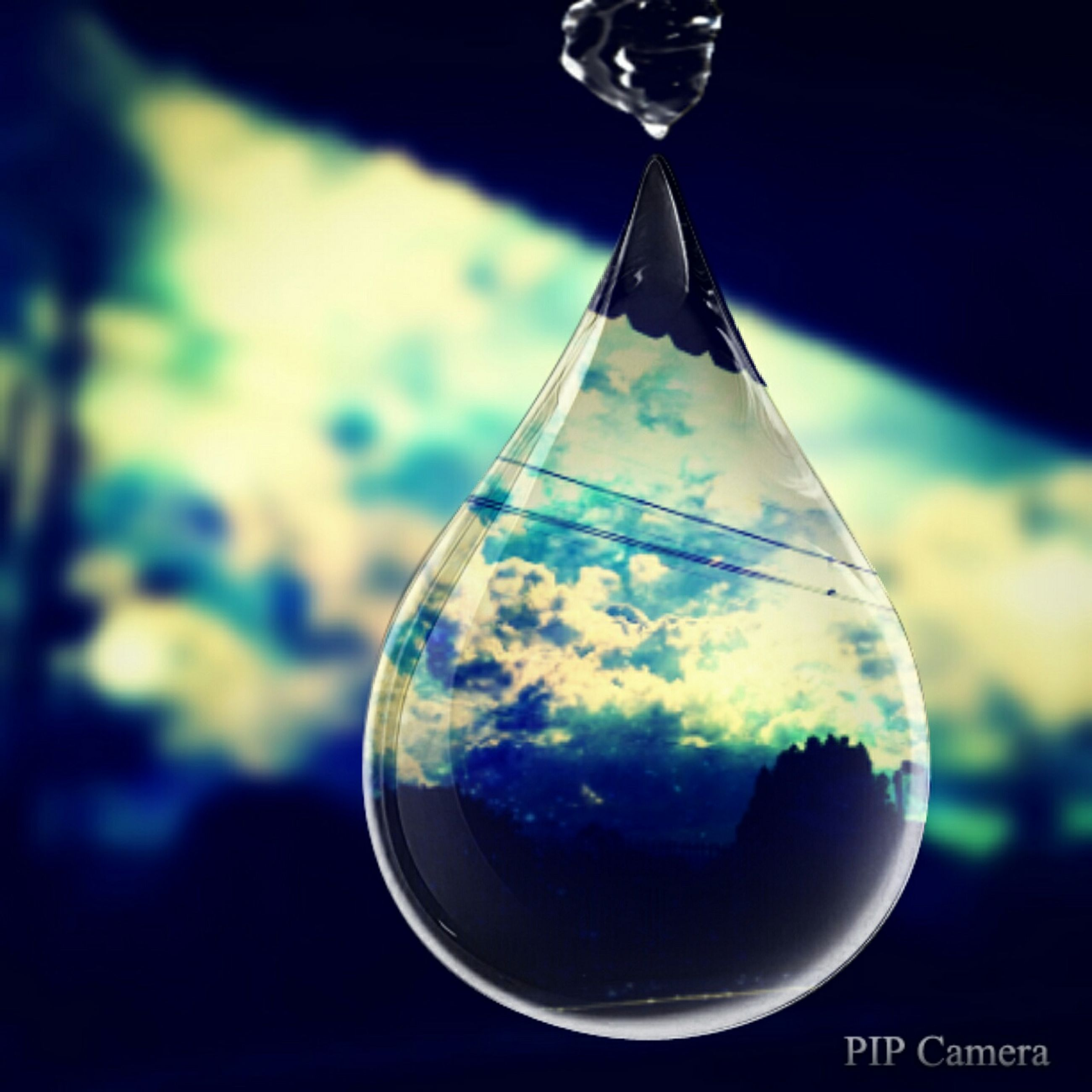 close-up, focus on foreground, blue, sphere, transparent, no people, selective focus, single object, glass - material, still life, part of, reflection, hanging, indoors, day, mid-air, circle, bubble, shape