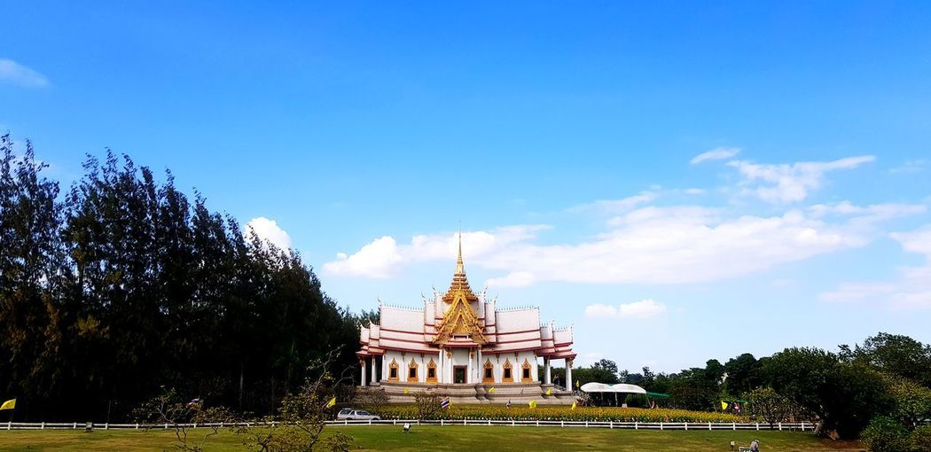 View of temple building against blue sky