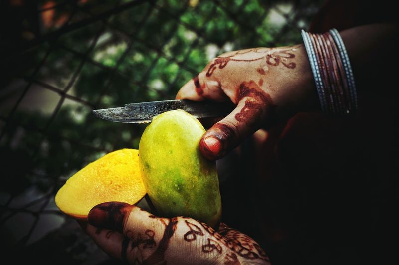 No summer can be called truly Summer without feasting on Mangoes..also summer days means mom flaunts her mehendi arts every now and then. The Essence Of Summer Hello World Close-up Mangoes Summer Time  India Guwahati Delicious ♡ Delicate Ripe Fruit Women Style Mehendi Hands At Work Indian EyeEm Food Photography Eyeem Peoples The Portraitist - The 2016 EyeEm Awards