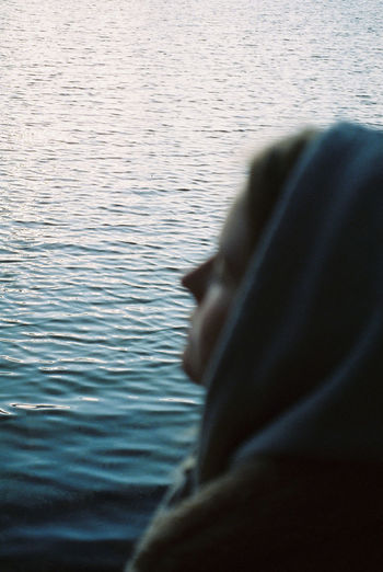 Portrait of woman in  front of a lake