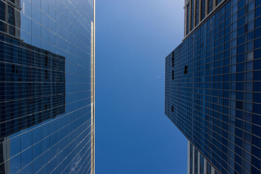 Modern Canyon Architecture Blue Building Exterior Built Structure City Clear Sky Day Julhofragaphotography Low Angle View Modern No People Outdoors Reflection Sky Skyscraper Window