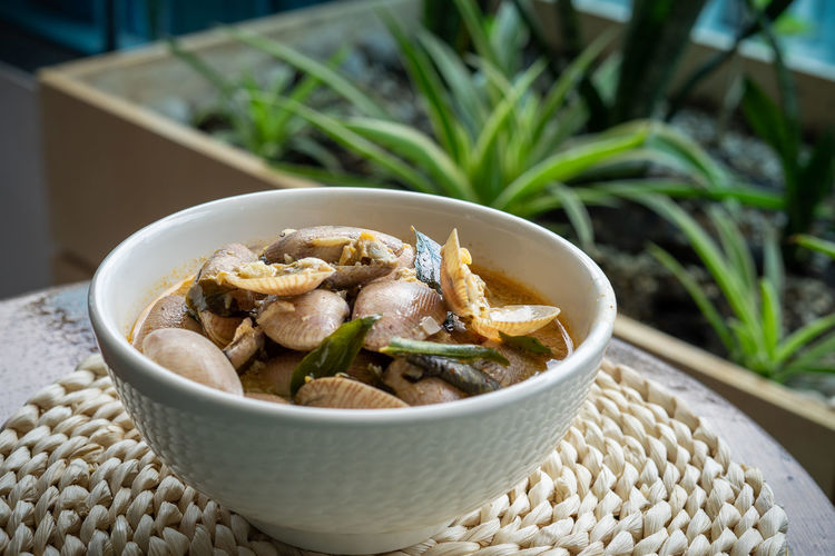 Chilli butter cream clam served in a bowl on a table.