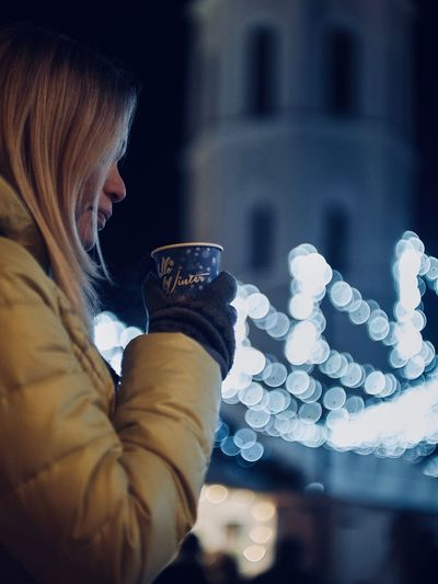 Xmas Building Exterior Close-up Coffee - Drink Coffee Cup Drink Drinking Focus On Foreground Food And Drink Illuminated Night One Person Outdoors People Real People Refreshment Side View Warm Clothing Winter Women Young Adult Young Women
