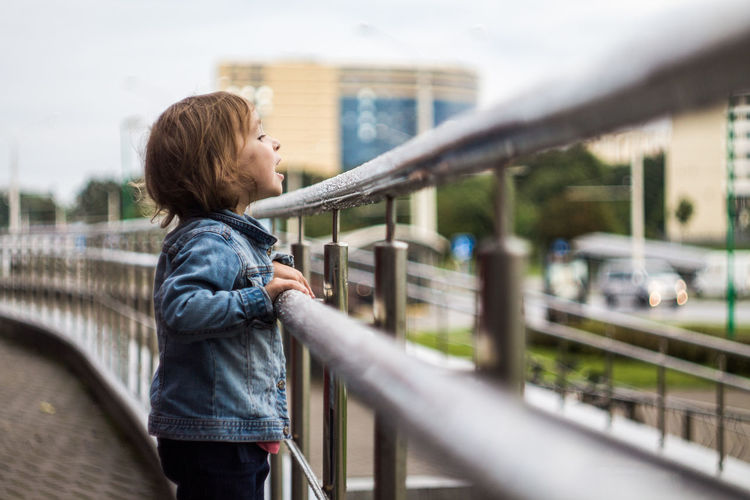 Architecture Bridge - Man Made Structure Built Structure Casual Clothing Child City Day Hair Hairstyle Looking One Person Railing Side View Standing Young Adult