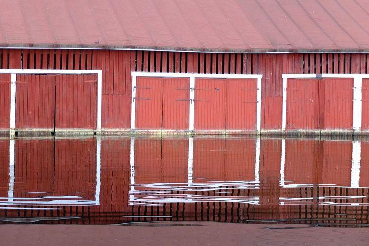 Building reflecting on lake