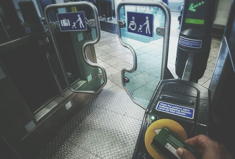 Human Body Part Human Hand Communication One Person Wireless Technology Technology Transportation Lifestyles Day Indoors  People Adults Only Adult Oyster  Oyster Card Contactless Payement Contactless Payment Card