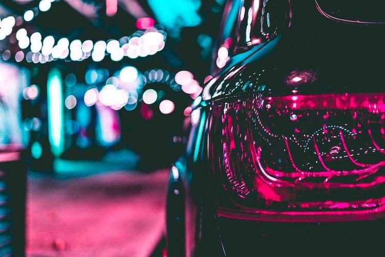 Lights Reflecting On Car At Night