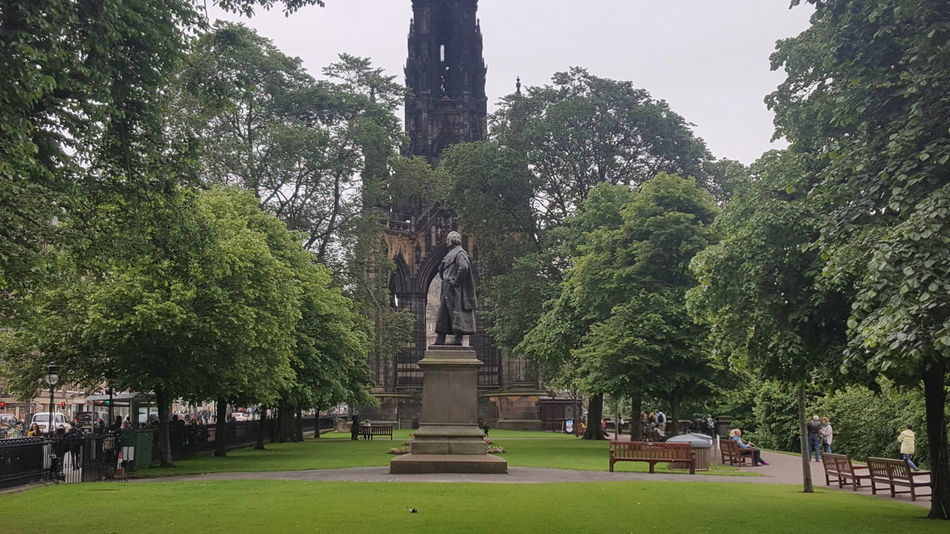 "The Scott Monument is a Victorian Gothic monument to Scottish author Sir Walter Scott. It is the largest monument to a writer in the world. It stands in Princes Street Gardens in Edinburgh, opposite the Jenners department store on Princes Street and near to Edinburgh Waverley Railway Station, which is named after Scott's Waverley novels. The tower is 200 feet 6 inches (61.11 m) high, and has a series of viewing platforms reached by a series of narrow spiral staircases giving panoramic views of central Edinburgh and its surroundings. The highest platform is reached by a total of 287 steps (those who climb the steps can obtain a certificate commemorating their achievement). It is built from Binny sandstone quarried near Ecclesmachan in West Lothian. In terms of its location, it is placed on axis with South St David Street, the main street leading off St Andrew Square to Princes Street, and is a focal point within that vista, its scale being large enough to totally screen the Old Town behind. As seen from the south side, Princes Street Gardens, its location appears more random, but it totally dominates the Eastern Section of the gardens, through a combination of its scale and elevated position relative to the sunken gardens. Following Scott's death in 1832, a competition was held to design a monument to him. An unlikely entrant went under the pseudonym ""John Morvo"", the name of the medieval architect ofMelrose Abbey. Morvo was in fact George Meikle Kemp, forty-five-year-old joiner, draftsman, and self-taught architect. Kemp had feared his lack of architectural qualifications and reputation would disqualify him, but his design (similar to an unsuccessful one he had earlier submitted for Glasgow Cathedral) was popular with the competition's judges, and in 1838 Kemp was awarded the contract to construct the monument. John Steell was commissioned to design a monumental statue of Scott to rest in the space between the tower's four columns. Steell's statue, made from white Carrara marble, shows Scott seated, resting from writing one of his works with a quill pen and his dog Maida by his side. The monument carries 64 figures (carried out in three phases) of characters from Scott's novels by a variety of Scots sculptors including, Alexander Handyside Ritchie, John Rhind, William Birnie Rhind, William Brodie, William Grant Stevenson, David Watson Stevenson, John Hutchison,George Anderson Lawson, Thomas Stuart Burnett, William Shirreffs, Andrew Currie, George Clark Stanton, Peter Slater, and two female representatives, Amelia Robertson Hill (who also made the statue of David Livingstone immediately east of the monument), who contributed three figures to the monument, and the otherwise unknown Katherine Anne Fraser Tytler. The foundation stone was laid on 15 August 1840. Following permission by an Act of Parliament (the Monument to Sir Walter Scott Act 1841 (4 & 5 Vict.) C A P. XV.), construction began in 1841 and ran for nearly four years. The tower was completed in the autumn of 1844, with Kemp's son placing the finial in August of the year. The total cost was just over £16,154. When the monument was inaugurated on 15 August 1846, George Meikle Kemp himself was absent; Kemp having fallen into the Union Canal while walking home from the site on the foggy evening of 6 March 1844 and drowned. In total (excluding Scott and his dog) there are 68 figurative statues on the monument of which 64 are visible from the ground. Four figures are placed above the final viewing gallery and are only visible by telephoto or (at a very distorted angle) from the viewing gallery itself. In addition, eight kneeling Druid figures support the final viewing gallery. There are 32 unfilled niches at higher level. Sixteen heads of Scottish poets and writers appear on the lower faces, at the top of the lower pilasters. The heads (anti-clockwise from the NW) represent: James Hogg; Robert Burns; Robert Fergusson; Allan Ramsay; George Buchanan; Sir David Lindsay; Robert Tannahill; Lord Byron; Tobias Smollett; James Beattie; James Thomson; John Home; Mary, Queen of Scots; King James I of Scotland; King James V of Scotland; and William Drummond of Hawthornden. In total, 93 persons are depicted, plus two dogs and a pig. In the early 1990s it was proposed that the stonework should be cleaned. There were views for and against cleaning and a scientific/geological investigation, including cleaning trials on samples of stone, was carried out. It was decided not to clean the stone due to the damage it would sustain. A restoration programme was undertaken involving replacing old repairs and damaged areas with Binny stone for which purpose the original quarry was re-opened. The fresh stonework contrasts with the smoke-darkened original. The overall cost of the restoration was £2.36 million and was funded by the Heritage Lottery Fund, Historic Scotland and the City of Edinburgh Council. The monument is now administered by the Culture and Sport division of the City of Edinburgh Council. The monument is featured prominently in the movie Cloud Atlas, as a location which the character Robert Frobisher frequents. Architecture Architecture & Statues Architecture Facade Architecture Photography Architecture_bw Architecturelovers EyeEm Best Shots From My Point Of View Gothic Gothic Architecture Historical Monuments Landscape Landscapes Medieval Princes Street Princes Street Gardens Scotland Scott Scott Monument Scottish Statue Statues Victorian Victorian Architecture Walter Scott"