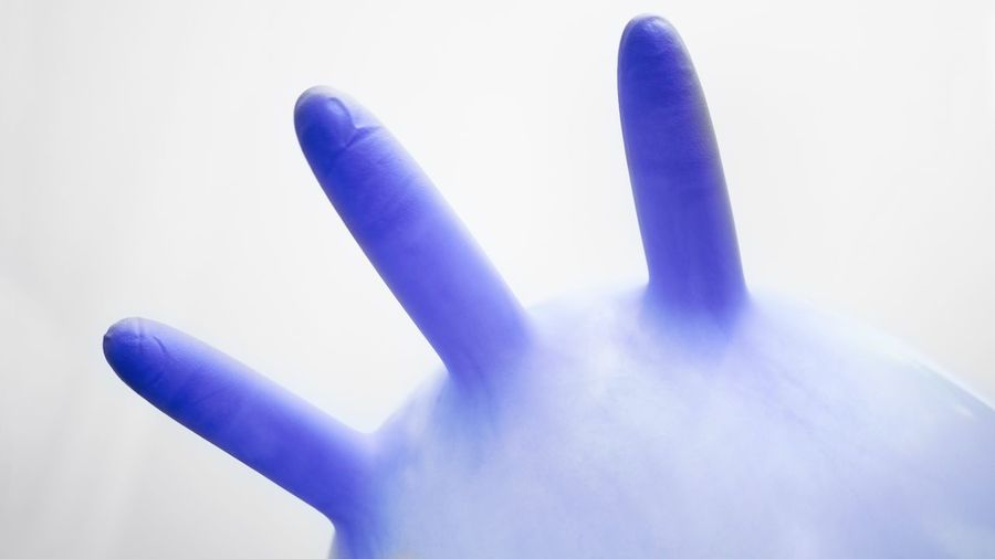 Close-up of human hand against white background