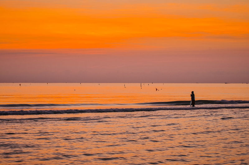 Start Your Day At Samila Beach Songkhla Thailand Sunset Sky Beauty In Nature Scenics - Nature Orange Color Water Silhouette Sea Tranquility Tranquil Scene Cloud - Sky Idyllic Nature Horizon Land Unrecognizable Person Outdoors Non-urban Scene One Person Horizon Over Water