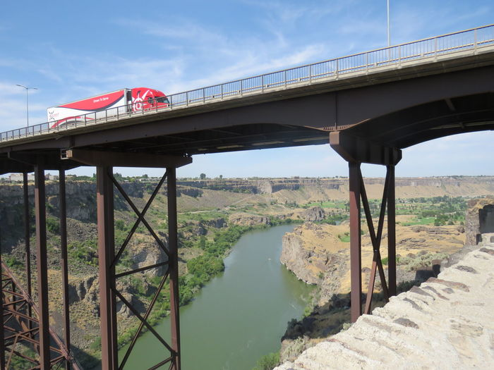 Business Stories Bridge Over The River Red Truck Bridge Bridge - Man Made Structure Built Structure Connection River Transportation Truck Truck On Bridge