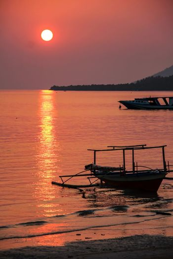 Favourite Moments EyeAmNewHere Bunaken Island Tourism In Indonesia Sunset Sky Beauty In Nature Scenics - Nature Transportation Tranquility Sea Silhouette Tranquil Scene