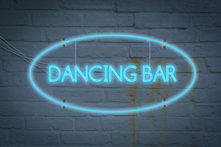 Leon lighton the wall with the word dancing bar