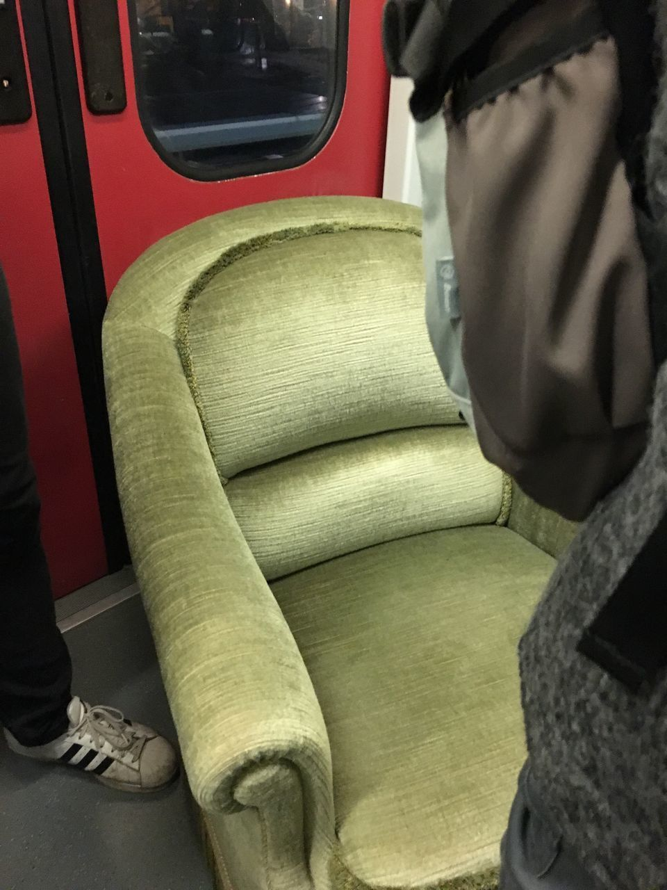 real people, mode of transport, public transportation, transportation, land vehicle, sitting, low section, day, vehicle seat, one person, men, indoors