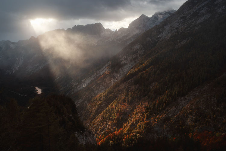 Mountain Scenics - Nature Beauty In Nature Tranquil Scene Cloud - Sky Landscape No People Mountain Peak Sky Nature Outdoors Mist Fog Alps Sunrays Sunbeam Cloudscape Scenics Autumn Fall Moody Sky Scenery Cliff Film Travel
