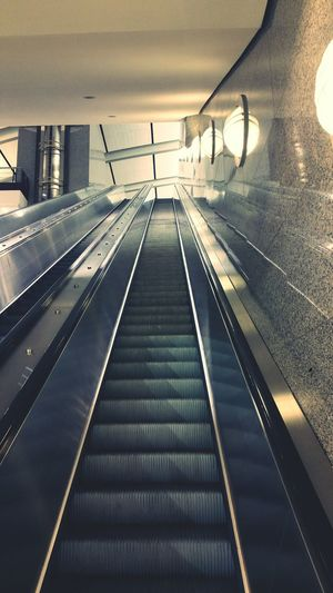 """Life is like an escalator. You see, it carries you on regardless. And you might as well enjoy the view and seize every opportunity while you're passing. Otherwise, it'll be too late."" ~Sophie Kinsella~ Going Up Escalators The Way Up No People Indoors  Airport Terminal Travelling"