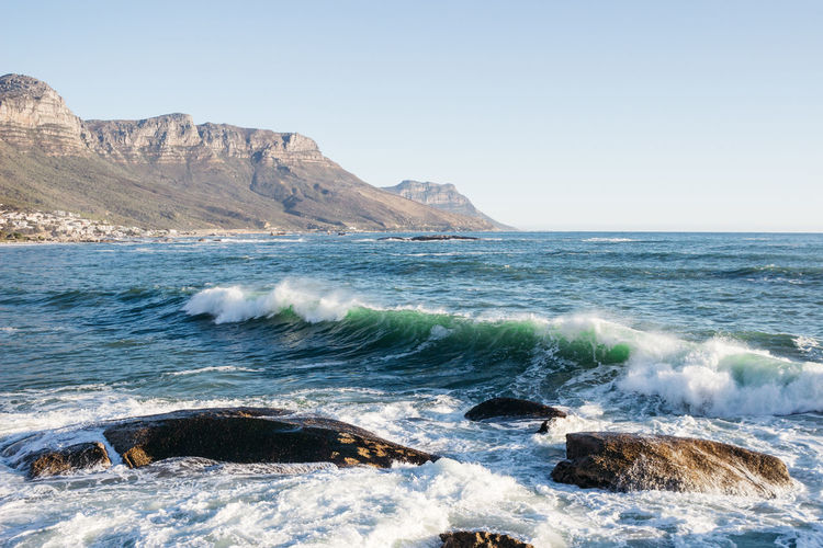Daylight Be. Ready. Cape Town Travel Adventure Beauty In Nature Blue Clear Sky Day Horizon Over Water Jonnynichayes Mountain Nature No People Ocean Outdoors Popular Photos Rocks Scenics Sea Stayandwander Surfing Tranquility Travel Destinations Water Wave