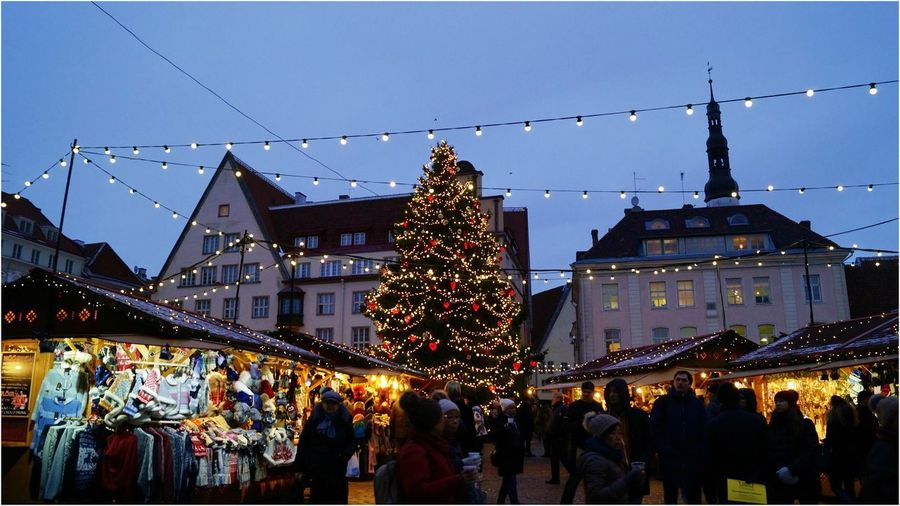 Architecture Building Exterior Built Structure Celebration Christmas Christmas Decoration Christmas Lights Christmas Market City Clear Sky Crowd Illuminated Large Group Of People Lifestyles Men Night Outdoors People Real People Sky Tradition Women