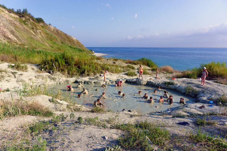 The people taking mud baths from blue clay Sun Vacations Day Large Group Of People Party - Social Event Cloud - Sky Sky Cloudscape Seaside Clouds Seascape Water Beach Scenics Blue Sky Landscape Nature Muddy Waters Mud Bath Blue Clay Summer Bath Beauty In Nature People Outdoor
