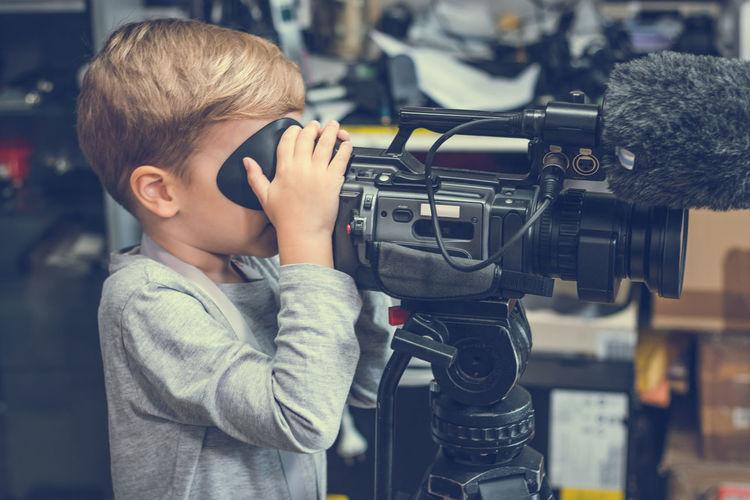 Boy Using Television Camera