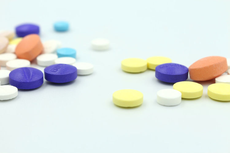 Close-up of medicine on white background