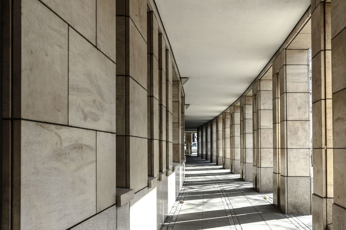 Architectural Column Architectural Feature Architecture Building Built Structure Column Corridor Day Diminishing Perspective Empty In A Row Modern Narrow No People Pillars Repetition Sky The Way Forward Vanishing Point Walkway