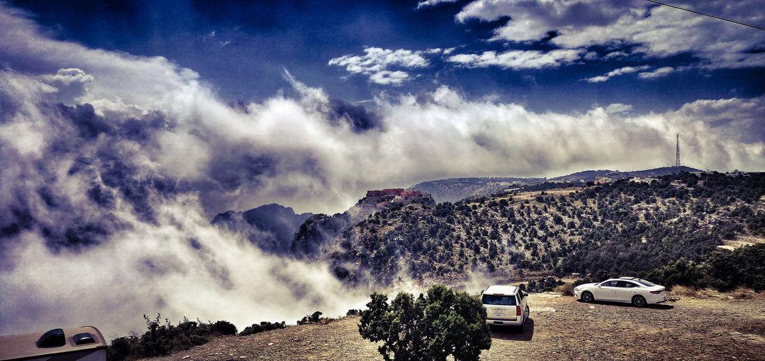 Panoramic shot of car on road against sky