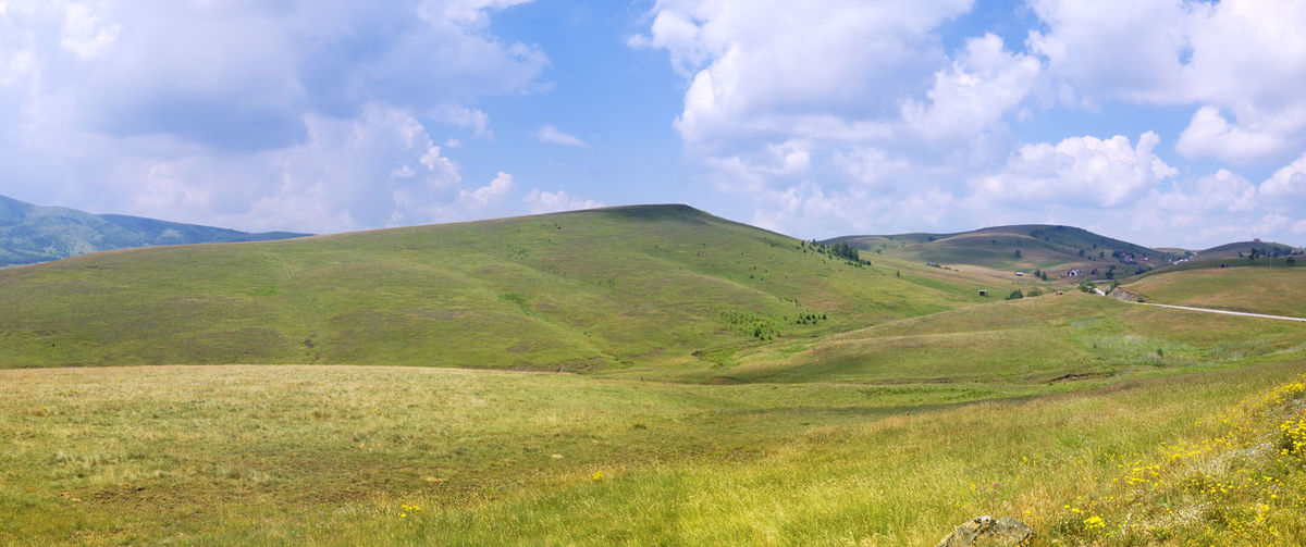 Grassland on Zlatibor Mountain in West Serbia in Springtime Cloud - Sky Scenics - Nature Landscape Sky Beauty In Nature Environment Tranquil Scene Tranquility Mountain Green Color Land Non-urban Scene Nature No People Grass Day Idyllic Outdoors Rolling Landscape Zlatibor Serbbia Grass Panorama Springtime Blue